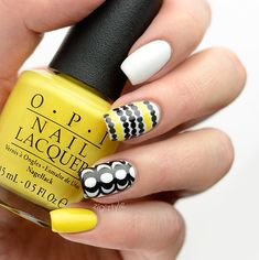 Inspired by Marimekko's wonderful furnishings print pattern.  Black & yellow nails