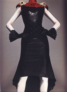 """Alexander McQueen for House of Givenchy Haute Couture, Autumn/Winter 1997-98  Ensemble, Eclect Dissect Dress of black leather; collar of red pheasant feathers and resin vulture skulls; gloves of black leather   Photographed by Sølve Sundsbø for Alexander McQueen: Savage Beauty   """"[In this collection,] my idea was this mad scientist who cut all these women up and mixed them all back together.""""   """"I don't think like the average person on the street. I think quite perversely sometimes."""""""