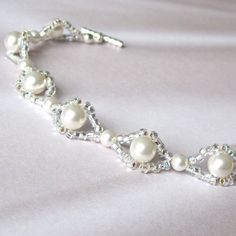 Items similar to Woven bridal bracelet white Swarovski pearl silver seed bead on Etsypearls and beads.I can see polymer clay beads instead of pearls.too many seed beads around the pearls.pearls and beads. Try this with less sparkly beads. Armband Swarovski, Bracelet Swarovski, Bridal Bracelet, Swarovski Pearls, Wedding Jewelry, Diy Bracelet, Pearl Bracelet, Gold Necklace, Wire Jewelry