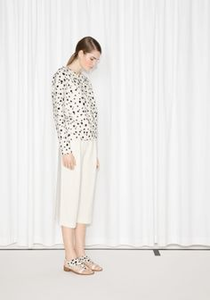 Mixed print and embroidery cover this soft sweatshirt with dalmatian dots giving it a crisp and playful look.