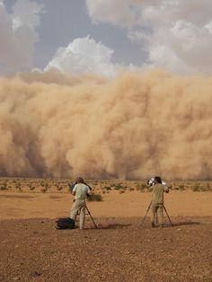 """Principal cinematographer on 4 episodes of NG series, """"Great Migrations & colleague John Mans caught in a massive sandstorm."""
