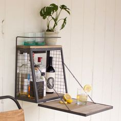 Wall-hanging bar shelf. Cool way to store your drinks (like chocolate milk, apple juice, and Dr. Pepper).