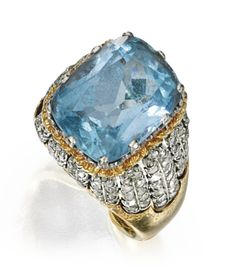 18 KARAT TWO-COLOR GOLD, AQUAMARINE AND DIAMOND RING, BUCCELLATI Centered by a modified-cushion cut aquamarine weighing approximately 7.25 carats, accented by numerous round diamonds, size 5, signed Buccellati,