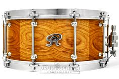 Angel Segmented Stave Rosewood Snare Drum 14x6.5 Natural Gloss Angel Drums are exclusively artisan made instruments built to impress. Meticulously crafted under one roof to the finest detail and accompanied by a 100% lifetime warranty, serious players can rest assured that Angels will outlive us all. Purchase Here: http://www.drumcenternh.com/drums/snare-drums/angel-segmented-stave-rosewood-snare-drum-14x6-5-natural-gloss.html