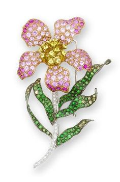 A gem-set brooch set designed as a flower, the leaves set with tsavorite garnets and brilliant-cut diamonds, the petals with pink sapphires and diamonds, mounted in 18k white and blackened gold