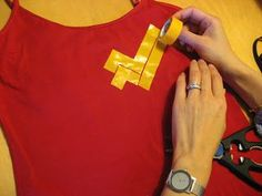 Use an old shirt or tank top & create your own superhero logo using electric tape! Grab a shirt or two from Chez Thrift and be ready for every costume occasion on your calendar!
