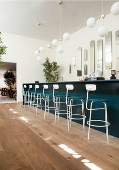 white stools against blue bas cabinets - COPENHAGEN RESTAURANT ITALY DESIGNED BY NORM | THE STYLE FILES