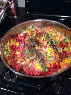 Quinoa  veggie stew-Great winter dish,  hearty and vegan! garlic, onion, pepper carrots, celery in the first round in the pan, then added the rosemary whole. Add 'softer' veg: zucchini, corn, beans, Add 1 sm can tomato sauce and broth/water. Bring to simmer; add quinoa, let that sit/grow for 15 minutes then add the chopped up kale, fresh herbs (rosemary!)