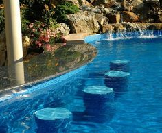 Vinyl Pool Swim-Up Bar: For the ultimate in outdoor socializing, guests can walk up to, or swim up to, this U-shaped bar and sit on patio or in-pool stools.
