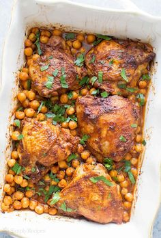 One pot easy baked chicken thighs with smoked paprika, onions, and chickpeas!. So good! On www.simplyrecipes.com: