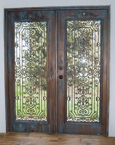 Plain white Home Depot metal doors are made to look like Old Bronze wrought iron doors with Modern Masters Metal Effects | Project by decorative artist Tamra Cook