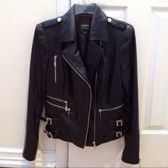 SALE  Bebe Genuine Leather Jacket Beautiful soft leather jacket with zippers on sleeves and front. In excellent condition only worn a few times. Classic jacket. Goes with every outfit. Lightly padded shoulders. bebe Jackets & Coats