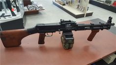 Belt-fed firearm chambered in 7.62x39mm, this RPD has been modified into an SBR (Short Barreled Rifle), with an 11.5″ long barrel. Note the adapter in the first photo that allows for the use of M249 drums or ammo sacks.