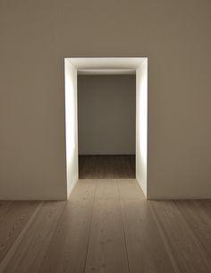 Lighted doorway inside the Plain Space installation by John Pawson. #GISSLER #interiordesign