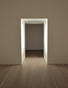 Lighted doorway inside the Plain Space installation by John Pawson. #GISSLER #interiordesign