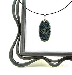 Blue Ceramic Necklace Textured with Corals and Shells: Beach Themed Jewelry by MiriHardyPottery. $26.00, via Etsy.
