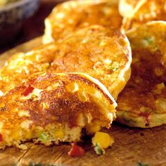 Stir corn, green onions, and sweet pepper into these buttermilk pancakes for savory flavor. Serve the tender vegetable cakes as a side dish with grilled fish, chicken, or beef.
