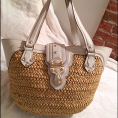 """HOST PICK- MK Santorini LG Shopper. NWT Michael Kors- Beautiful basket weave LG Shopper. Perfect for beach, vaca or everyday. Material= Woven husk & leather. Color= Vanilla. Details= Fold over flap closure w/mag snap. Int is lined w/natural colored linen fabric. 1 int zip pckt & 1 multi & 1 cell pckt on opposite wall. Bttm panel has 4 large rivet studs w/leather flange surrounding to help protect breakage. H= 11""""; L= 20""""; 17""""; 9"""". W= 5-9"""". Bottom panel= H= 7.5""""; H= 11""""; W= 5"""". Handle drop…"""