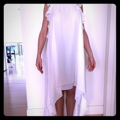 BCBG white dress with train This dress was only worn once at my baby shower! It is white with a high neckline. The front is short and the back flows into a train. It is very lightweight and flowy. BCBG Dresses Wedding