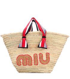 Miu Miu - Borsa in rafia - Miu Miu vi accompagna nelle giornate estive con la borsa in rafia beige rifinita da dettagli multicolor. Il logo ricamato della maison firma il modello con un indiscutibile tocco di stile. seen @ www.mytheresa.com