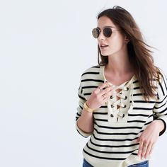 A cozy pullover sweater in crisp blue-and-white mariner stripes. The perfect way to wear our favorite lace-up neckline right past iced-coffee season.