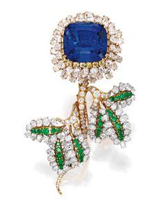 Platinum, 18 Karat Gold, Tanzanite, Emerald, Colored Diamond and Diamond Brooch…