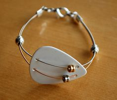 Guitar Pick and Guitar String Bracelet For the next time I break some of my strings!