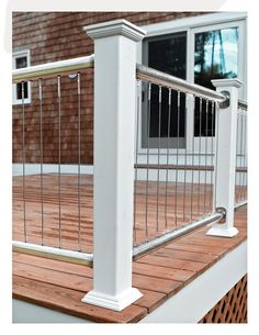 Cool deck railings - cable deck rail. Wood posts, round stainless steel top and bottom rail. Vertical steel cable infill-- unique!