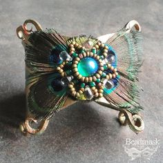 Hera's Cuff Leather Peacock Feather Bracelet Accented by beadmask, $75.00