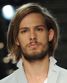 Long reddish brown straight hairstyle with beard