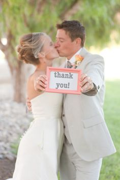 Framed thank you sign-make sure your photog is prepped for this one. so simple to the do your own thank you cards.