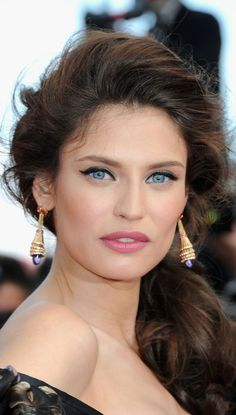Bianca Balti  This is a good example of just using liner and mascara/lashes on the upper eyelids. Softer lip. It's a nice look.