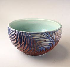 """Meticulously hand carved and beautifully glazed in shades of red and blue, this stunning bowl draws you in to get lost in its beauty. This large bowl is 6"""" in diameter and stands approximately 3.5"""" tall making it the perfect size for serving a salad or even your favorite entree. This a one of a kind piece so don't mi"""