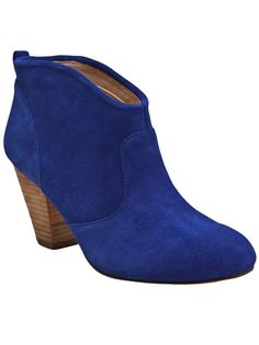 Marks ankle bootie in royal blue from Report Signature. This suede ankle pull-on boot features a round toe, curved shaft, and stacked wooden heel. Heel measures 3.5