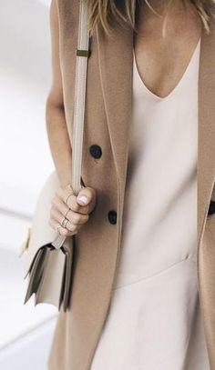 sleeveless coat. neutrals.