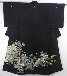 This is a glamorous Kurotomesode Kimono with a design of 'Matsu'(pine tree) and seasonal flowers, which is dyed by Hiroshi Yata, a Kaga-yuzen dyer