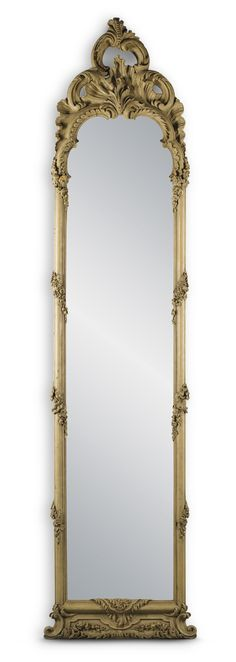 A large Dutch Rococo carved and crème painted trumeau mirror, 18th century 325cm. high, 80cm. wide; 10ft. 8in., 2ft. 7½in.