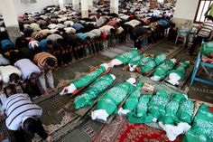 The price of a Jewish state: Palestinian mourners at the funeral of members of the Abu Jami family, 25 of whom were killed when Israel bombed their house in Khan Younis, 21 July. (Ezz al-Zanoun / APA images)