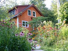 The use of native tall grasses among the flowering perennials gives the gardens the desired casual feel.