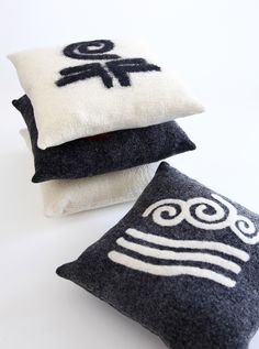 mesele handmade felt cushions with element symbols