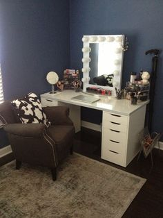 Lots to like here- the lit mirror, the IKEA Alex drawer unit, the dark grey wall, the make up storage. Nice.