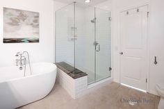 A free standing tub and separate shower with glass door. #OneWeekBath #Spa…