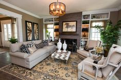 Soft neutrals and warm browns fill this comfortable, tasteful great room. A fireplace serves as the focal point of the space, while accents and decor bring personality to the design.