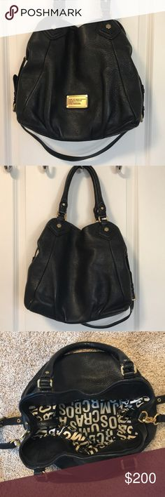 Marc Jacobs black bag Classic black medium-sized Marc Jacobs purse with gold hardware. In good condition, minor interior stains, no visible exterior wear. Great everyday purse. Marc By Marc Jacobs Bags Totes