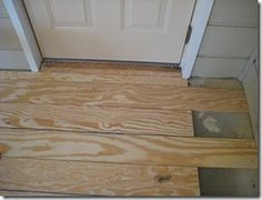 DIY Plywood Plank Floors...i am seeing alot of this..interesting!