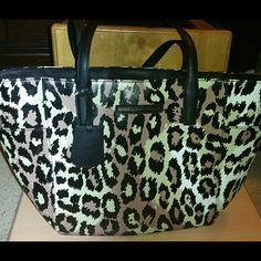"Today only Diane von Furstenberg Tote Bag NWT Firm price  DIANE VON FURSTENBERG ON THE GO LEO TOTE BAG  BRAND NEW WITH TAGS ATTACHED AND DIANE VON FURSTENBERG CARE CARD  The bag measures 11.5"" across the bottom, 10.5"" High, 7"" Wide. The dual leather straps drop 7.5"" to the top of the bag.  Double leather top handles.  Magnetic snap closure.  Two internal zip pockets.  Two internal patch pockets.  Two external patch pockets.  Fully lined.  Metal feet at base of bag. DVF INTERIOR TAG AND DVF…"