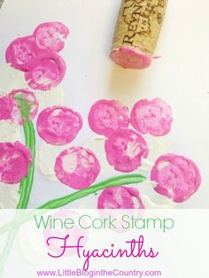 Crafts and DIY's don't have to cost an arm and a leg. To create these Wine Cork Stamp Hyacinths only take paint, paper, and a wine cork. If you are a crafter I bet you already have these on hand.