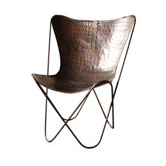 The Iron Sling Chair brings modern design to an ancient material. Inspired by the graceful, curving form of a paperclip, the chair provides a poised presence in any space.  Find the Iron Sling Chair in Bronze, as seen in the The Whiskey Tasting Room Collection at http://dotandbo.com/collections/the-whiskey-tasting-room?utm_source=pinterest&utm_medium=organic&db_sku=KLL0106-bronze