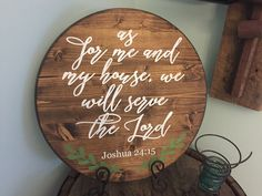 As for me and my house we will serve the lord sign. Made from wood and handpainted. DETAILS: • Size: 17.5 diameter, round • Black with white