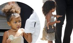 North West carries an expensive Louis Vuitton bag on her arm